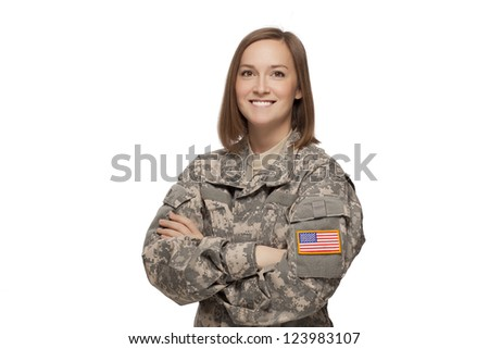 Military female with her arms crossed - stock photo