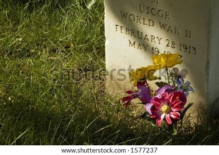 Military Gravestone and Flowers - Horizontal - stock photo