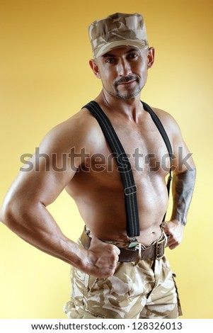 military guy with a sports body in the cap - stock photo