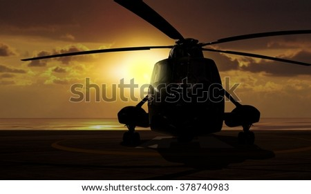 Military helicopter on carrier ship at sunset - stock photo