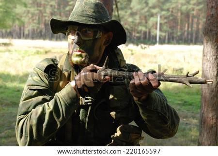 Military jokes - suspicious disarmament - stock photo