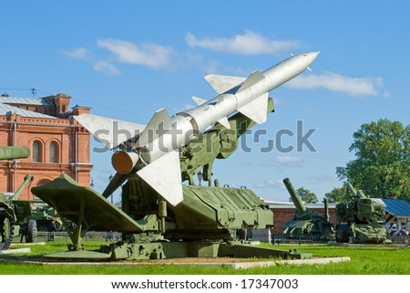 Military launcher with a rocket - stock photo