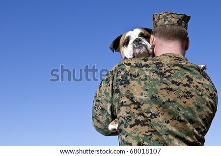 Military Man Hugs Dog - stock photo