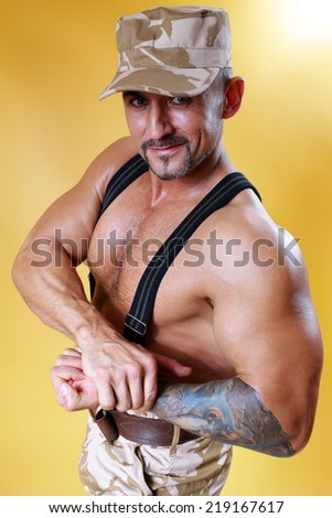 military man in cap and muscular body - stock photo