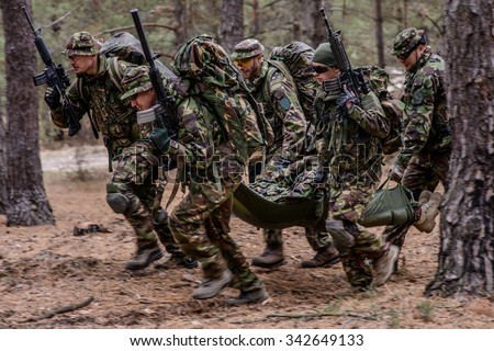 Military medical evacuation of wounded soldier - stock photo
