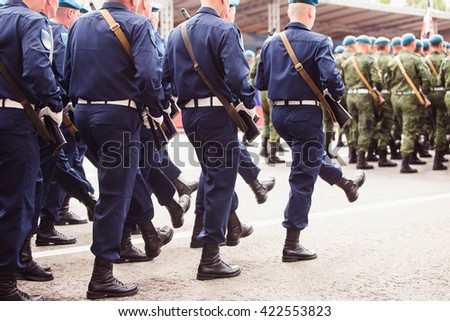 military men marching to victory parade - stock photo