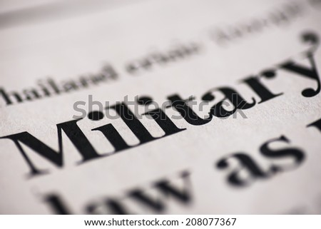 Military. Military word on real newspaper. Shallow dof.  - stock photo