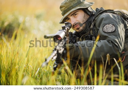military sniper aiming an assault rifle - stock photo