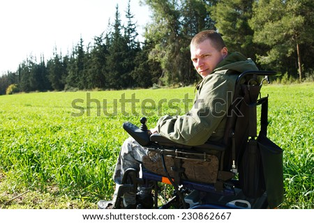 Military soldiers being wounded was in a wheelchair. - stock photo