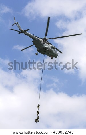 Military special forces during operation with a helicopter - stock photo