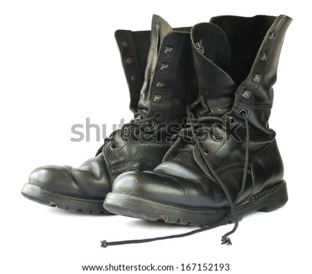 Military style black leather boots on white background. - stock photo
