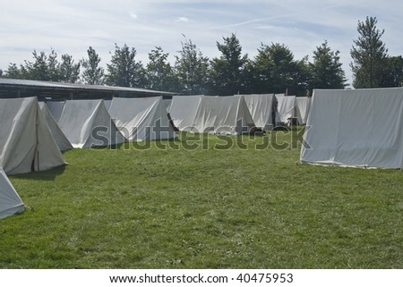 Military Style tents lined up at a Civil War Re-enactment - stock photo