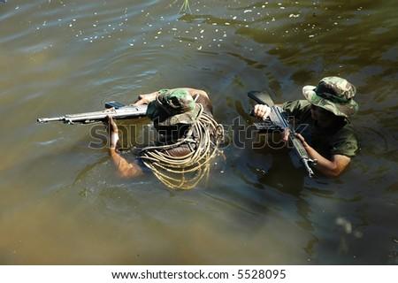 Military training combat - water environment - stock photo