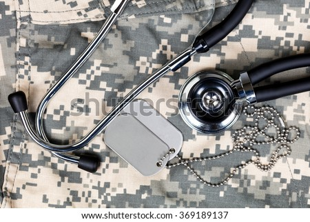 Military uniform with stethoscope and identification tags. Overhead view in horizontal layout. - stock photo
