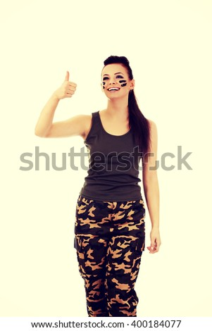 Military woman gesturing ok sign - stock photo