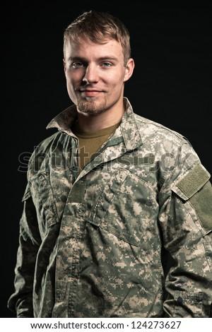 Military young man. Smiling. Studio portrait. - stock photo