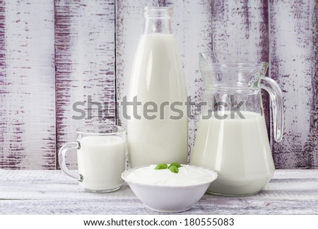 Milk and cream cheese on a vintage background - stock photo