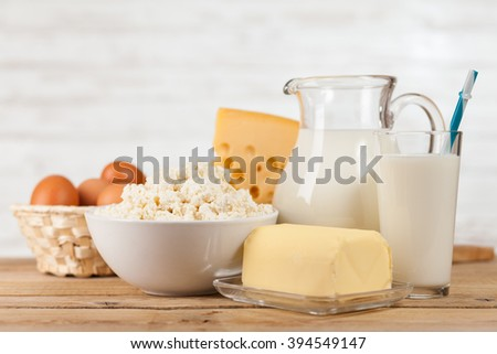 Milk and dairy products on a wooden table - stock photo