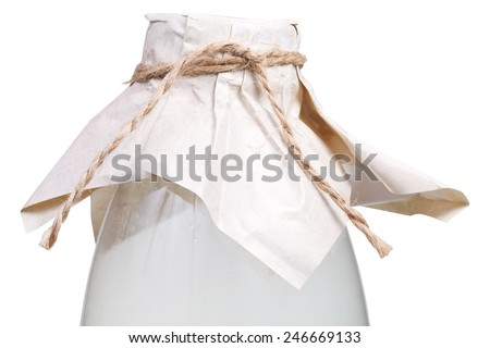 milk bottle closed by brown paper and tied with hemp rope isolated on white background - stock photo