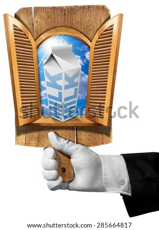 Milk breakfast in the morning / Hand of waiter holding a wooden cutting board with wooden window with open shutters, inside blue sky and white packaging of milk. Concept of healthy breakfast. - stock photo