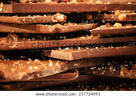 Milk chocolate with hazelnuts . - stock photo