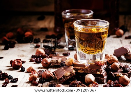 Milk chocolate with nuts and raisins with dark Jamaican rum, selective focus - stock photo