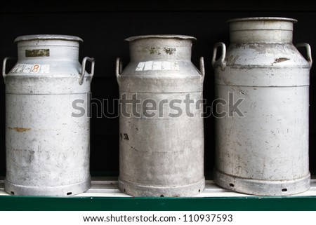Milk churns - stock photo