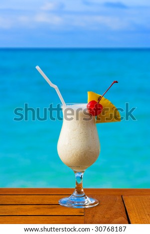 Milk cocktail on table at beach cafe - vacation background - stock photo