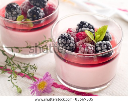 Milk dessert with raspberry and blackberry. Selective focus - stock photo