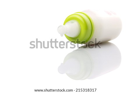 Milk in a baby bottle over white background - stock photo