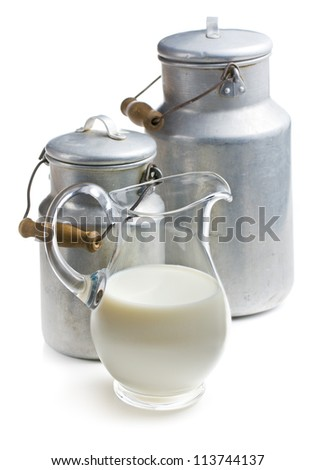 milk in a glass pitcher on white background - stock photo