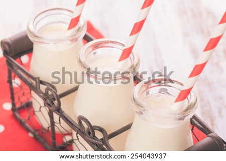 Milk in bottles with paper straws for children - stock photo
