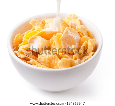 Milk pouring into a bowl of nutritious and delicious corn flake cereal isolated on white background (with clipping path) - stock photo