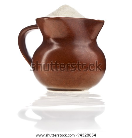 milk powder drink in clay pitcher Isolated on white background - stock photo