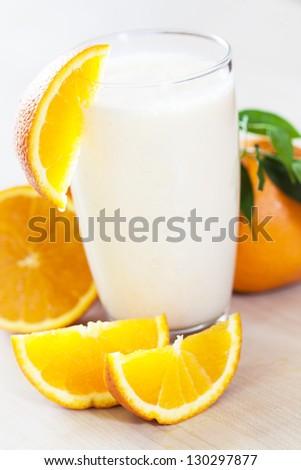 Milk shake with fruit -  orange. - stock photo