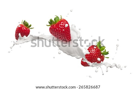 milk splash with strawberries isolated on white - stock photo