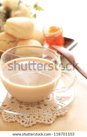 Milk tea with Scotland food scone for gourmet English breakfast image - stock photo