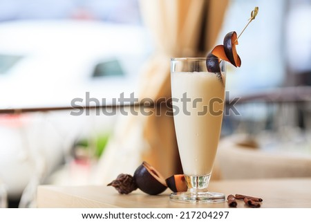 milkshake decorated with fresh plums - stock photo