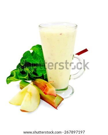Milkshake in a tall glass beaker with leaves and stalks of rhubarb, apple slices isolated on white background - stock photo