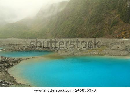 Milky blue pond of Fox Glacier, New Zealand - stock photo
