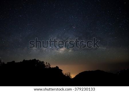 Milky Way over mountain - stock photo