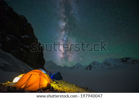 Milky way over Saribung Peak's high camp, Nepal - stock photo