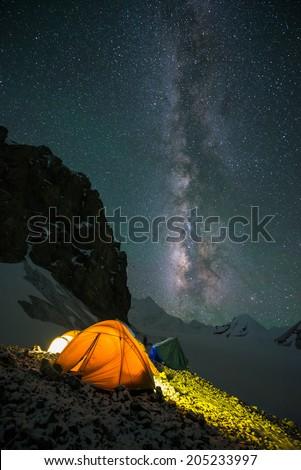 Milky way over Saribung Peak's high camp, Nepal - stock photo