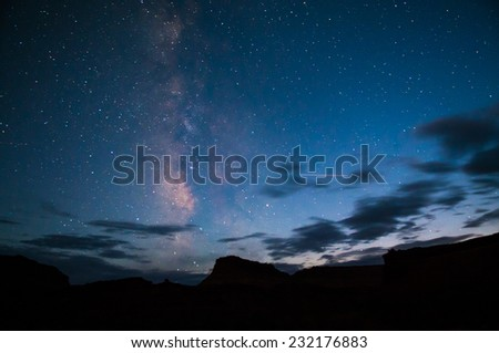 Milky way over the canyon Lake Powell Utah Landscape at night - stock photo