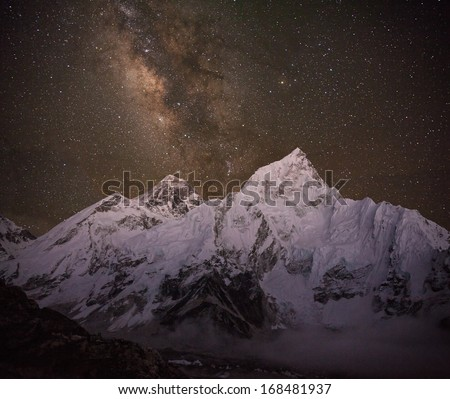 Milky Way over the Himalayan peaks. Everest peak (8848 m) and Nuptse peak (7861 m) at the night time. Canon 5D MkII. - stock photo