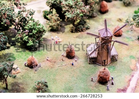 Mill and haymaking in historical miniature of russian life - stock photo