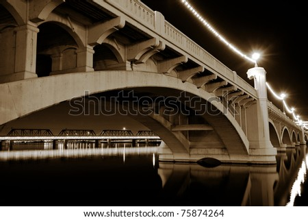 Mill Avenue Bridge across the Salt River in Tempe Arizona photographed at night in black and white.e - stock photo