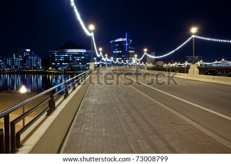 Mill Avenue Bridge entrance to downtown Tempe crossing Tempe Town Lake photographed at Night. - stock photo