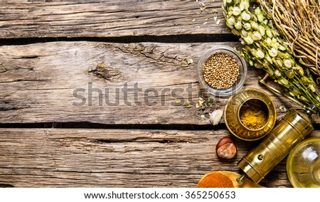 Mill with aromatic spices and herbs. On wooden background. Free space for text . Top view - stock photo