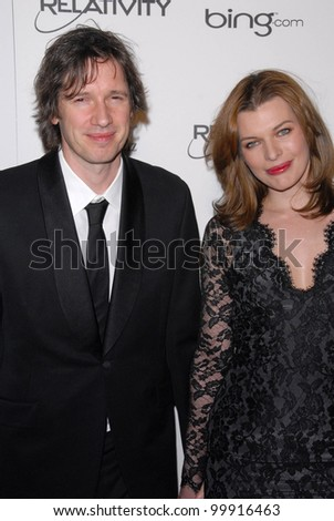 "Milla Jovovich, Paul W.S. Anderson at the 2011 Art Of Elysium ""Heaven"" Gala, Annenberg Bldg., California Science Center, Los Angeles, CA. 01-15-11 - stock photo"